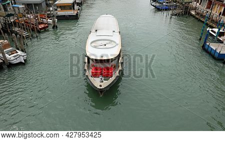 Solitary Vaporetto Boat  In The Grand Canal In Venice Without Boats Due To The Lockdown