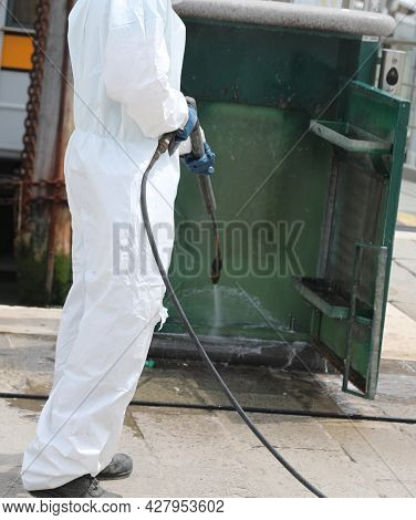 Disinfestation With A Pressure Washer Of Street Furniture During The Coronavirus Epidemic With The W