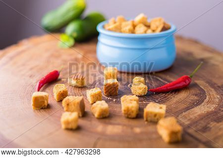 Square-shaped Bread Crumbs In A Blue Pot On A White Background. Oven-fried Golden Brown Bread Crumbs