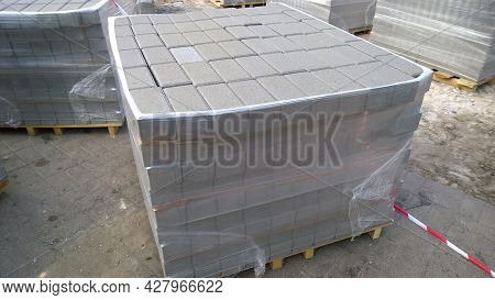 Block Of Contemporary Stone Paving Slabs Pavers. Building Material On Pallet For Road Paving. Sidewa