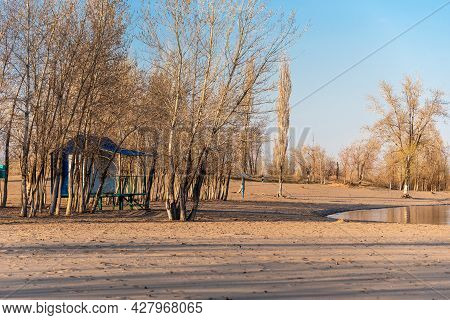 Autumn Landscape - Beach House On An Empty Sandy Beach With Trees Without Leaves