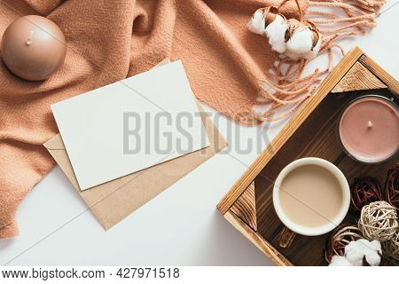 Autumn Composition. Feminine Desk Table With Letter, Blank Paper Card, Brown Scarf, Cotton On White