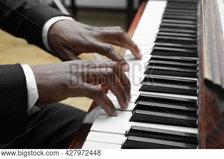 African-american Man Playing Piano Indoors, Closeup. Talented Musician