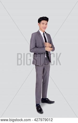 Portrait Young Asian Businessman In Suit Smiling With Confident And Friendly Isolated On White Backg