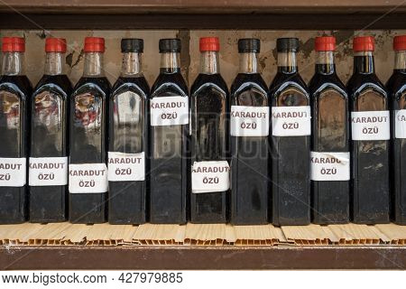 Black mulberry juice extract in bottles for sale in Sirince village near Selcuk town, Izmir, Turkey. Karadut ozu means black mulberry extract in turkish