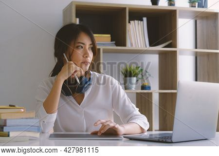 Beautiful Young Asian Woman Using Digital Tablet At Home. Student Female In Living Room. Online Lear
