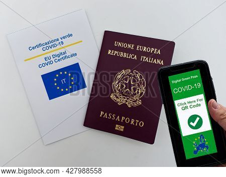 Digital Green Pass Covid-19 Of Eu On Smartphone Held By Hand. Italian European Passport And Eu Digit