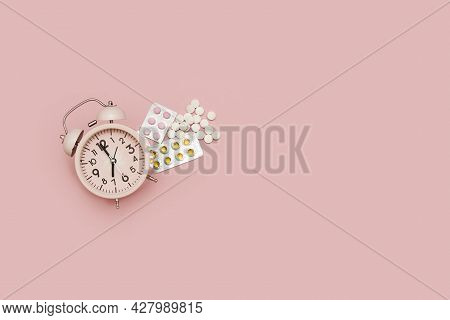Time To Strengthen The Body Or Health System. Vitamins, Medicines And Medical Pills With Alarm Clock