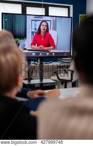 Diverse Business Team Having Videomeeting Discussing Online With Remotely Executive Manager In Busin