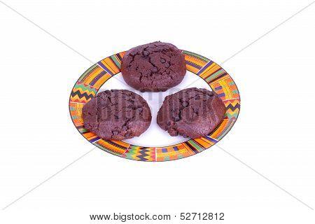 Three Chocolate Cookies On Plate