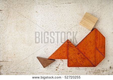 abstract sitting or relaxing figure built from seven tangram wooden pieces, a traditional Chinese puzzle game, rough white painted barn wood background poster