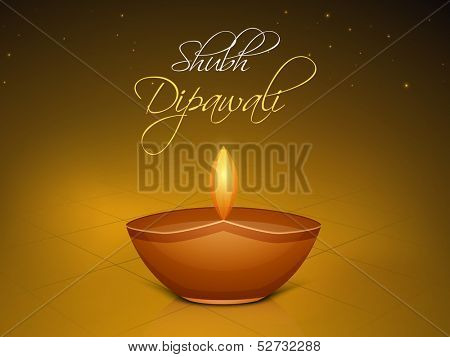 Indian festival of lights Shubh Dipawali (Happy Dipawali) concept with illuminated tradition oil lit lamp on shiny brown background.