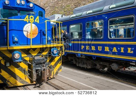 OLLANTAYTAMBO, PERU - JULY 16: Perurail  train between Aguas Calientes and Ollantaytambo in the Andes at Cuzco Peru on july 16, 2013. PeruRail was founded in 1999 by Lorenzo Sousa and Sea Containers