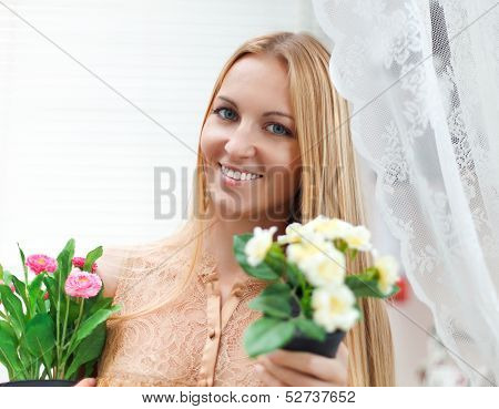 Young Blond Woman In A Comfortable Terrace