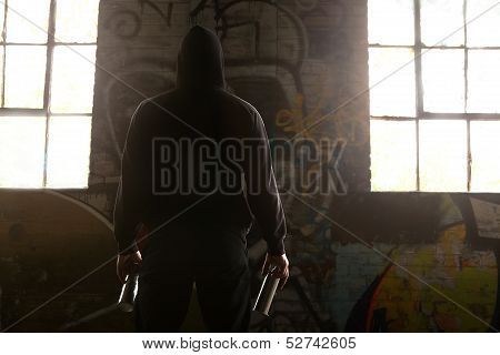 Young Man Facing A Wall And Ready To Do A Graffiti