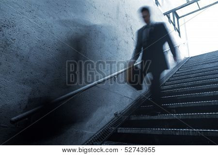 Busy Businessman Rushing Down The Stairs