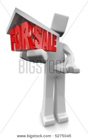 Real Estate Agent Holding A 3D House For Sale