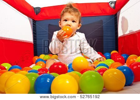Baby Inside Playpen With Balls