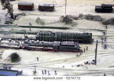 Model of steam locomotives on railway depot in winter