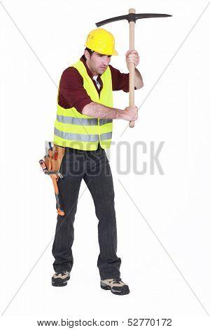 Man using a pickaxe