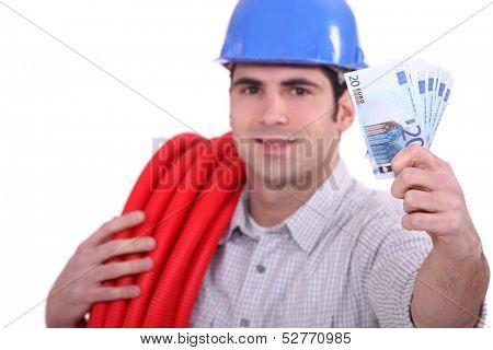 Plumber holding cash