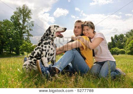Couple With A Dalmatian