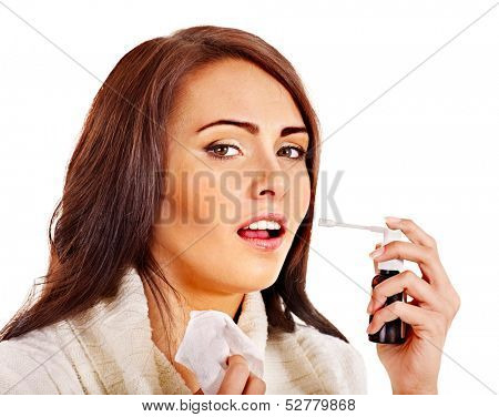 Young woman using throat spray. Isolated.