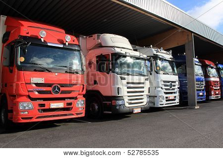 Mercedes-benz And Scania Trucks In A Carport