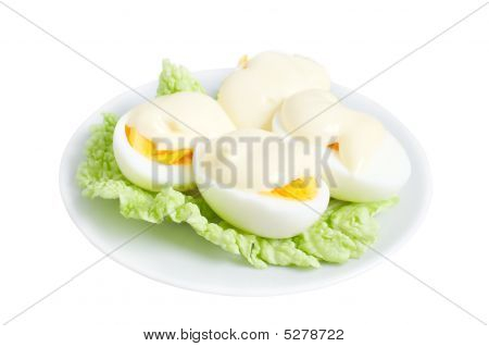 Eggs With Mayonnaise On Green Lettuce Leaf