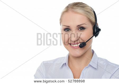 Confident smiling female customer support staff over white poster