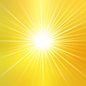 Summer background with a magnificent sun burst with lens flare. Hot with space for your message poster