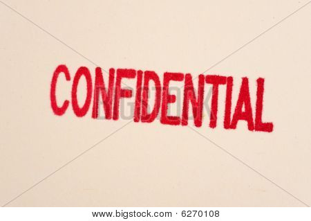 Red Confidential Stamp On A Folder
