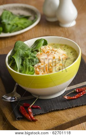 A spicy fragrant prawn laksa soup topped with spinach poster