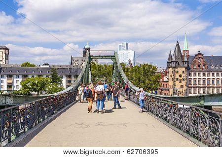 People On Bridge Eiserner Steg In Frankfurt, Germany.