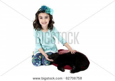 Young girl with black lab puppy smiling isolated on white background poster