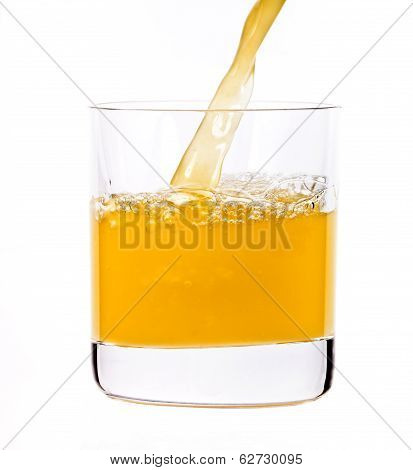 Juice Pouring Into The Glass
