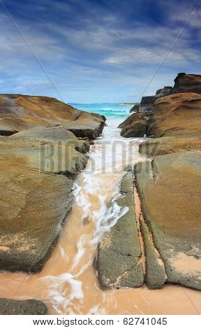 Steadfast,  Sea Wash Through Rock Crevice