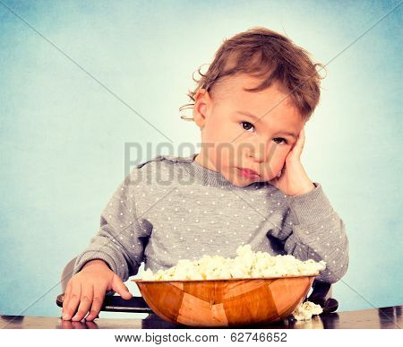 Worried child holding his hand on the head poster