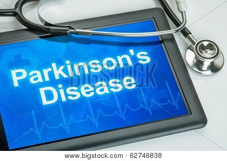 Tablet with the diagnosis parkinson's disease on the display
