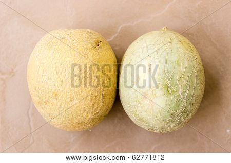 A pair of musk melon or cantaloupe on an isolated background