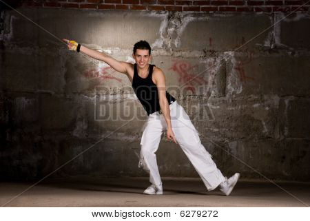 Hip hop men dancing in modern style over grey brick wall poster