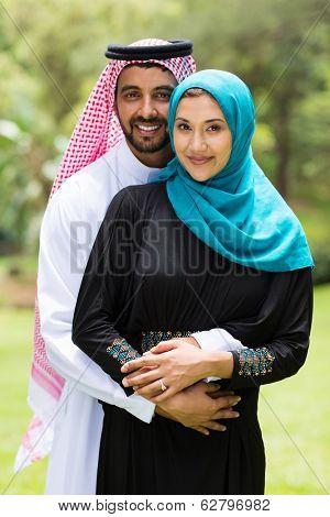 modern Arabian couple hugging outdoors