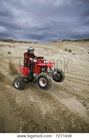 Atv Rider Pulling A Wheelie