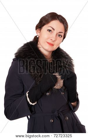 Girl In A Black Coat Holding Purse