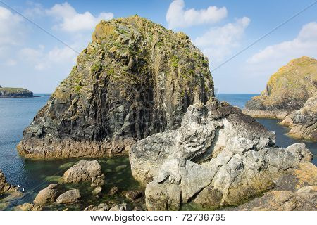 View from the harbour wall of rocks near Mullion harbour Cornwall UK situated on Mounts Bay