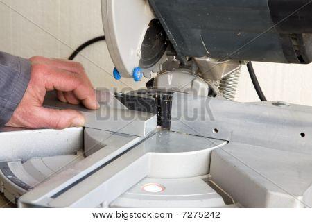 Craftsman Cutting A Piece Of Aluminium.