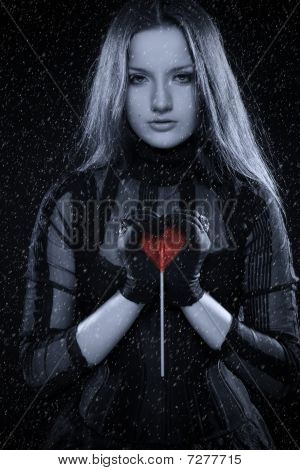 Cold Gothic Girl With Red Heart In Her Hands