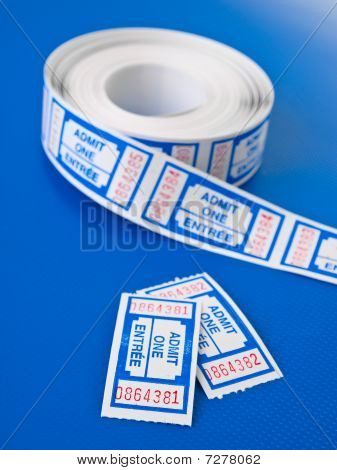 Pair Of Tickets On Techno Blue Background Vertical View