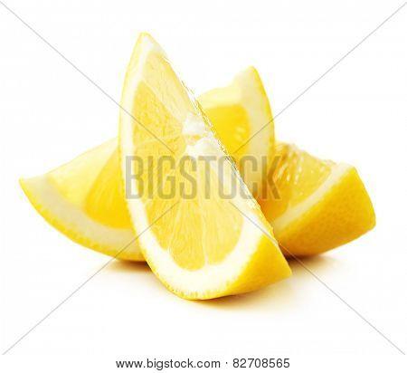 Juicy slices of lemon isolated on white