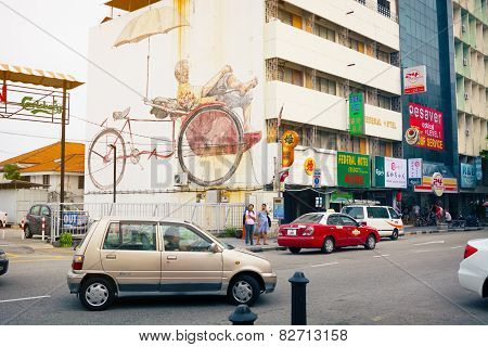 Malaysia, Penang, Georgetown - Circa Jul 2014: Traffic Passes On A Public Street With A Large Mural